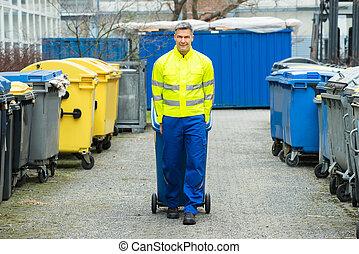 Male Worker Walking With Dustbin On Street - Happy Male...
