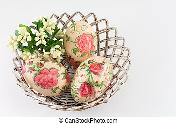 Easter eggs in a basket on white
