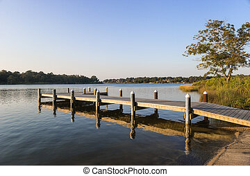 Fishing Pier Early Morning - Fishing pier and boat launch in...