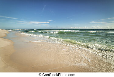 Sunny Gulf of Mexico Beach and Surf - Wide angle view of...