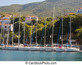 sail boats in a greek island - sailing boats with tourists...