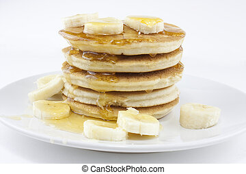 banana pancakes or crepes - Pancakes or crerpes on a white...