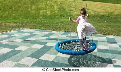 girl play on a net swing - Slow motion of happy girl play on...