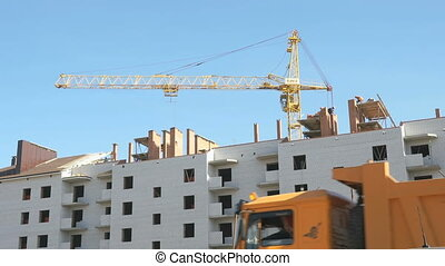 Construction of the apartment houses. Crane works -...
