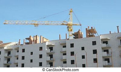 Construction of the apartment houses. Crane works