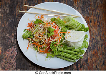 Thai papaya salad also known as Som Tam from Thailand -...