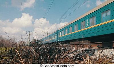 Train Rides on Rails The train moving at a high speed on...