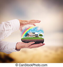 Dream house - Man holds in his hands a house