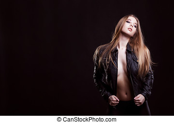 Sexy woman in leather jacket and no bra posing fashion on...