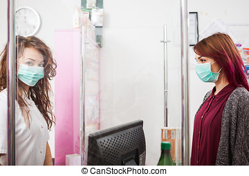 Pharmacist and client with mask