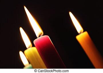 Burning candles black background