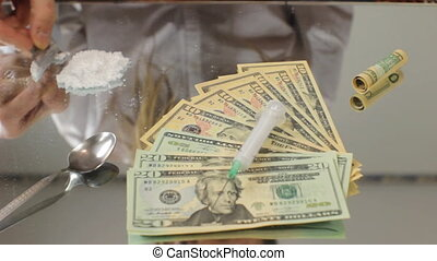 Drug Dealer 1 - Drug dealer preparing coke or heroin for...