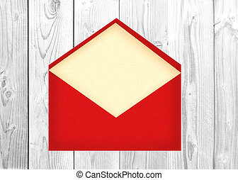 Red letter envelope with paper cardover white wooden...