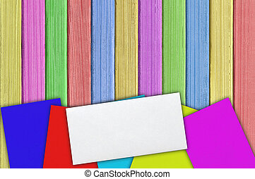 many colorful envelopes on the color wooden paint background