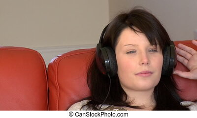 Attractive woman listening music