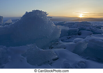 Ice dragon looking at the rising sun.