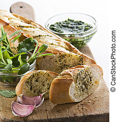 Garlic bread - Freshly baked garlic bread with herbs close...