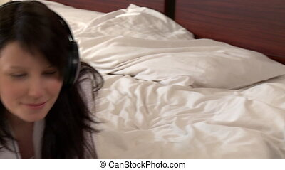 Smiling woman lying down on bed
