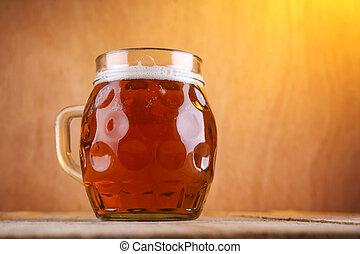 Dimpled beer mug - Dimpled mug with amber beer on a grunge...