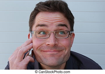 Funny looking man telephone call - Happy funny looking man...