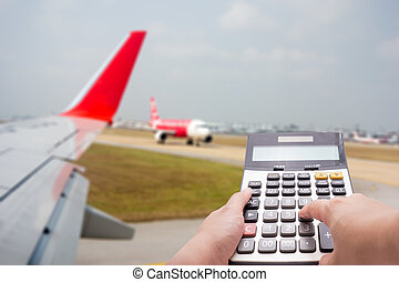 Travel cost calculation concept by calculator and airplane...