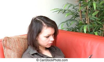 Cute woman sending a text message - Caucasian woman sending...