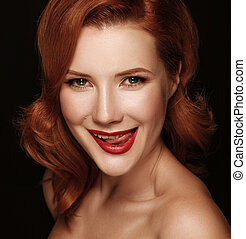 Close-up portrait of a smiling beautiful red-haired girl He...