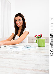 Young beautiful woman with a Laptop at home