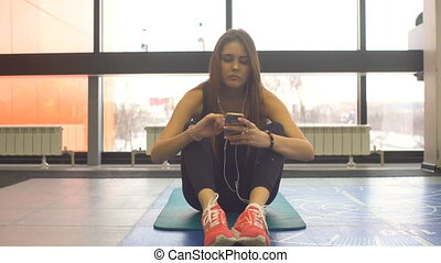 beautiful girl doing exercise on the press at the gym