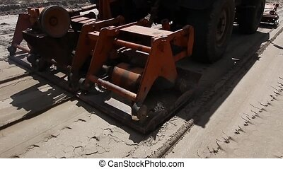 Close of plate compactor mounted on - Plate compactor is...