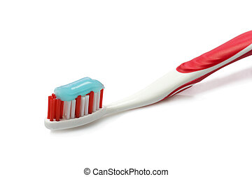 Dental care - Red toothbrush with toothpaste - isolated on...