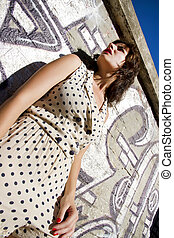 Retro dotted girl - A vintage style dressed girl leaning at...
