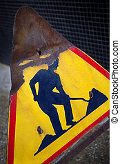 Old road sign - Damaged road sign on a construction site