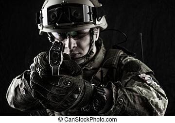 military man in italian camouflage aiming from handgun -...