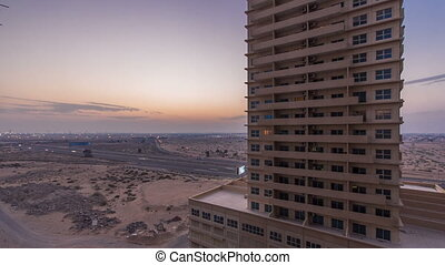 Cityscape of Ajman from rooftop day to night timelapse. Ajman is the capital of the emirate of Ajman in the United Arab Emirates.