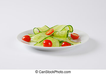thin cucumber slices and cherry tomatoes - thin slices of...