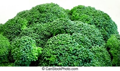 Broccoli Rotating On White - Closeup of large broccoli heads...