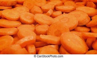 Cut Carrot Pieces Rotating Closeup - Macro shot of sliced...
