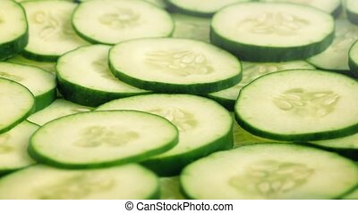 Cucumber Slices Rotating On Plate - Fresh cucumber slices...