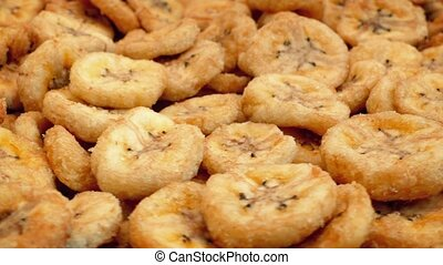 Dried Bananas Snack Food Rotating - Dehydrated banana pieces...