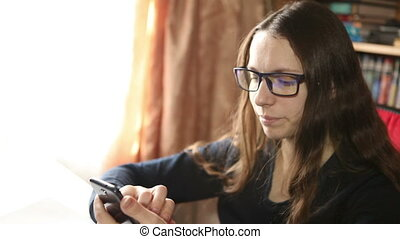 woman writes a message on a smartphone