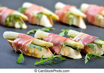 Finger food with asparagus - Dainty morsels with white...