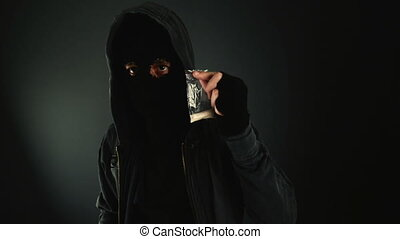 Drug dealer offering heroin - Unrecognizable hooded drug...