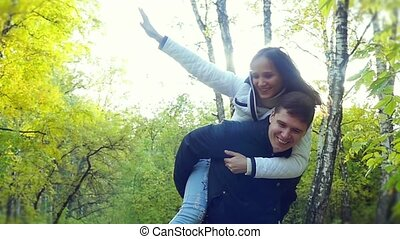 Active couple in love having fun and playing with the leaves...