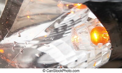 indicator light blinks in front of the car headlights