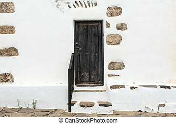 Old black door in Betancuria village on on Fuerteventura,...