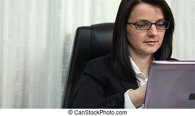 Woman Working In Office And Looking At Laptop Screen