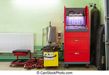 Injector repairing machine in car service station - Injector...