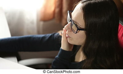 Girl with glasses talking on the phone while