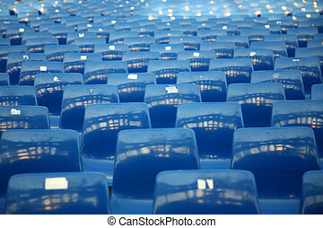 Empty blue seats in a concert hall